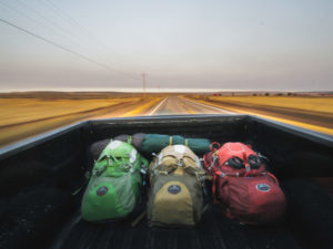 backpacks in pickup truck